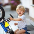 Little toddler boy repairing his first bike — Stock Photo