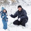 Father and toddler boy having fun with snow on winter day — Stock fotografie #32468201