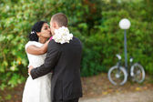 Beautiful indian bride and caucasian groom, in summer park. — Stock Photo