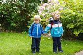 Two little toddler boys going to kindergarten. — Stock Photo
