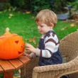 Adorable toddler boy with halloween pumpkin  — Stock Photo