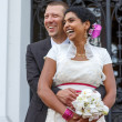 Beautiful indian bride and caucasian groom, after wedding ceremo — Stock Photo #33926265