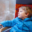 Stock Photo: Cute little boy looking out train window