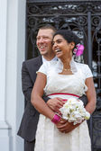 Beautiful indian bride and caucasian groom, after wedding ceremo — Stock Photo