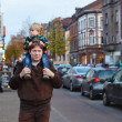 Adorable little son and father walking through city on evening. — Stock Photo
