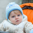 Little  boy one year old in warm winter clothes — Stock Photo
