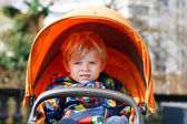 Portrait of toddler boy in autumn or spring clothes in orange st — Stock Photo