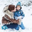 Little preschool boy and his mother playing with first snow in p — Stock Photo #34781627