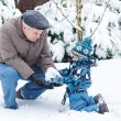 Stock Photo: Grandfather and toddler boy on winter day