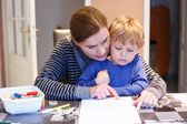 Little blond boy and his mother making together preschool homewo — Φωτογραφία Αρχείου