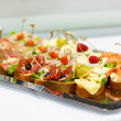 Different tasty snacks on luxury banquet table — Stock Photo