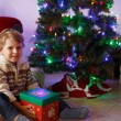 Little boy being happy about christmas present. — Zdjęcie stockowe