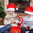 Two little sibling boys fighting about christmas present — Stock Photo