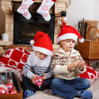 Two little sibling boys being happy about christmas present — Stock Photo #35884367