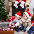 Two little sibling boys being happy about christmas present — Stock Photo #35884395