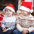 Two little sibling boys being happy about christmas present — Stock Photo #35884403
