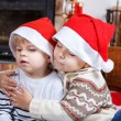 Two little sibling boys being happy about christmas present — Stock Photo #35884421
