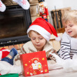 Two little sibling boys being happy about christmas present — Stock Photo #35884457