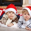 Two little sibling boys being happy about christmas present — Stock Photo #35884479