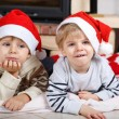 Two little sibling boys being happy about christmas present — Stock Photo #35884483