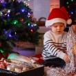 Adorable boy decorating Christmas tree — Stock Photo