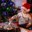 Adorable boy decorating Christmas tree — Stok fotoğraf