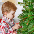 Little blond toddler boy decorating Christmas tree at home — Stock Photo