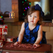 Little girl playing with christmas tree decoration — Stock Photo