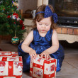Happy little toddler girl with Christmas presents — Stock Photo