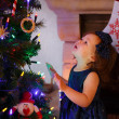 Little girl being happy about christmas tree and lights — Stock Photo