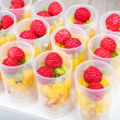 Fruit salad in push up cake forms — Stock Photo #35886031
