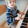 Little toddler boy playing piano at music school. — Stock Photo