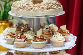 Wedding cake and cupcakes in brown and cream. — Stock Photo