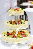 Wedding cake decorated fresh fruits and berries — Stock Photo
