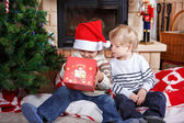 Two little sibling boys being happy about christmas present — Stock Photo