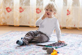 Cute toddler boy of two years eating chocolate — Stockfoto