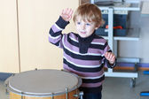 Little toddler boy playing drum at music school. — Stock Photo