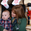 Beautiful young mother and adorable baby boy with Christmas deco — Stock Photo