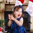 Little girl being happy about christmas tree and lights — Stock Photo #36574225