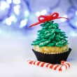Stock Photo: Christmas tree cupcake with white fondant frosting