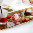 Triple dessert with chocolate and strawberry on wedding table se — Stock Photo