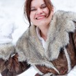 Young woman having fun with snow on winter day — Stock Photo