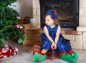 Happy little girl in santa shoes have a christmas. — Stock Photo