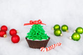 Christmas tree cupcake with white fondant frosting — Stock Photo