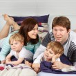 Stock Photo: Happy family of a four having fun at home
