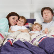 Happy family of a four having fun at home — Stock Photo #37228669