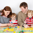 Happy family of a four having fun at home — Stock Photo #37228757