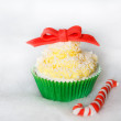 Stock Photo: Christmas cupcake with creme cheese and fondant frosting
