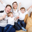 Happy family of a four having fun at home — Stock Photo #37233965