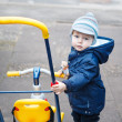 Little toddler boy in autumn park on bicycle . — Stock Photo